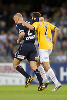 MELBOURNE, AUSTRALIA - NOVEMBER 06: Kevin Muscat of the Victory and Steve Pantelidis of Gold Coast United share a moment of sportsmanship during the round 13 A-League match between the Melbourne Victory and Gold Coast United at Etihad Stadium on November 6, 2010 in Melbourne, Australia (Photo by Sydney Low / Asterisk Images)