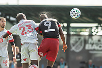 LAKE BUENA VISTA, FL - JULY 13: Chris Mavinga #23 of Toronto FC and Ola Kamara #9 of DC United battle for the ball during a game between D.C. United and Toronto FC at Wide World of Sports on July 13, 2020 in Lake Buena Vista, Florida.