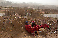 Members of the Red Ants resting during a dust storm. The Red Ants are a controversial private security company often hired to clear squatters from land and so-called 'hijacked' properties.