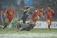 Luke McAlister of Stade Toulousain is tackled by Matt Smith and Ben Youngs of Leicester Tigers during the Heineken Cup 6th round match between Leicester Tigers and Stade Toulousain at Welford Road on Sunday 20th January 2013 (Photo by Rob Munro).