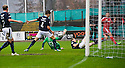 Dundee's Thomas Konrad knocks the ball into his own net for Aberdeen's first goal.