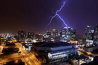 Aug. 14, 2012; lightning bolt storm monsoon rain downtown Phoenix city skyscraper building office night US Airways Center Mandatory Credit: Mark J. Rebilas