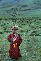 Monk holding a twig, Degang Valley, Kham, Tibet 2005.