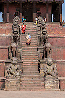 Bhaktapur, Nepal.  Guardians line the Stairs to the Nyatapola Temple:  Rajput Wrestler-guardians Jayamel (left) and Phattu (right), Elephants, Lions, Griffins, and Hindu Goddesses Baghini and Singhini.  The temple survived the April 2015 earthquake virtually undamaged.