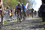 Riders, including Andre Greipel (GER) Lotto-Soudal, tackle Sector 18 la Trouee de Arenberg during the 113th edition of the Paris-Roubaix 2015 cycle race held over the cobbled roads of Northern France. 12th April 2015.<br /> Photo: Eoin Clarke www.newsfile.ie