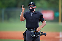 Umpire Denver Dangerfield during the WWBA World Championship at Lee County Player Development Complex on October 11, 2020 in Fort Myers, Florida.  Denver Dangerfield, a resident of  who attends , is committed to .  (Mike Janes/Four Seam Images)