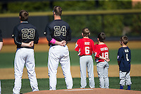 Drew Loepprich (23) and Gavin Sheets (24) of the Wake Forest Demon Deacons are joined on the field by youth baseball players for the National Anthem prior to the game against the Florida State Seminoles at David F. Couch Ballpark on April 16, 2016 in Winston-Salem, North Carolina.  The Seminoles defeated the Demon Deacons 13-8.  (Brian Westerholt/Four Seam Images)
