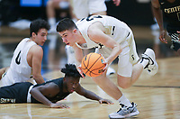 Bentonville guard Owen Dehrmann (24) picks up a loose ball, Saturday, November 14, 2020 during a basketball game at Bentonville High School in Bentonville. Check out nwaonline.com/201115Daily/ for today's photo gallery. <br /> (NWA Democrat-Gazette/Charlie Kaijo)