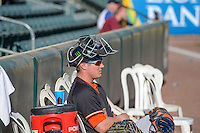 Tyler Heineman (8) of the Fresno Grizzlies sits in the bullpen before the game against the Salt Lake Bees in Pacific Coast League action at Smith's Ballpark on June 13, 2015 in Salt Lake City, Utah.  (Stephen Smith/Four Seam Images)