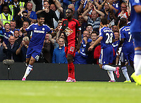 Pictured: Diego Costa of Chelsea (L) celebrates his hat trick third goal. Saturday 13 September 2014<br /> Re: Premier League Chelsea FC v Swansea City FC at Stamford Bridge, London, UK.