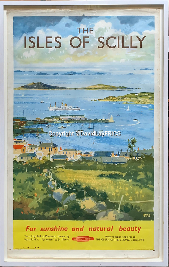 BNPS.co.uk (01202 558833)<br /> Pic: DavidLayFRICS/BNPS<br /> <br /> A stunning landscape makes up an Isles of Scilly poster<br /> <br />  A wonderful collection of vintage British travel posters celebrating the golden age of the seaside getaway have emerged for sale for £15,000.<br /> <br /> The posters were produced by Great Western Railway and British Railways between the 1930s to the 1960s to encourage Brits to holiday on the Cornish coast.<br /> <br /> One striking Art Deco poster issued by Great Western Railway shows a lady in an orange swimsuit at Newquay with surfers in the background. <br /> <br /> It describes the popular holiday destination as 'Cornwall's first Atlantic resort'.<br /> <br /> The collection of about 30 posters has been put together by a private collector over the past two decades who is now selling them with auction house David Lay FRICS, of Penzance, Cornwall.