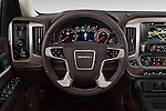 Car pictures of steering wheel view of a 2018 GMC Sierra 1500 Denali 4WD Crew Cab Short Box Denali 4 Door Pick-up Steering Wheel