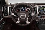 Car pictures of steering wheel view of a 2018 GMC Sierra 1500 Denali 4WD Crew Cab Short Box Denali 4 Door Pick-up Steering Wheel