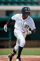 Detroit Tigers Esney Chacon (27) runs to first base during a Florida Instructional League game against the Pittsburgh Pirates on October 6, 2018 at Joker Marchant Stadium in Lakeland, Florida.  (Mike Janes/Four Seam Images)