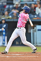 Asheville Tourists third baseman Ryan McMahon #5 swings at a pitch during a game against the  Lexington Legends at McCormick Field on May 16, 2014 in Asheville, North Carolina. The Tourists defeated the Legends 11-1. (Tony Farlow/Four Seam Images)