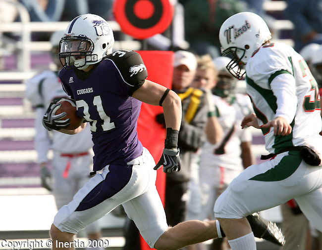 SIOUX FALLS, SD - NOVEMBER 21:  Adam Lopez #31 of the University of Sioux Falls returns a blocked punt past xxx #30 from Minot State in the first quarter of their first round NAIA playoff game Saturday afternoon at Bob Young Field in Sioux Falls. (Photo by Dave Eggen/Inertia).