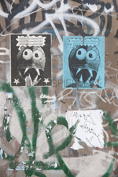Graffiti and Street Art Posters on a Wall, Essex Street, Lower East Side, New York City, New York State, USA....For editorial use only - inside a book, magazine or publication.  No property release for the street art posters.......