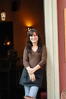 Poland, Krakow, Waitress outside restaurant, Kazimierz