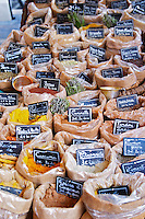 Street market merchant's stall with many different types of Provencal spices and herbs presented in small bags Sanary Var Cote d'Azur France