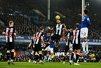 Newcastle United's Jamaal Lascelles heads clear under pressure from Everton's Djibril Sidibe<br /> <br /> Photographer Alex Dodd/CameraSport<br /> <br /> The Premier League - Everton v Newcastle United  - Tuesday 21st January 2020 - Goodison Park - Liverpool<br /> <br /> World Copyright © 2020 CameraSport. All rights reserved. 43 Linden Ave. Countesthorpe. Leicester. England. LE8 5PG - Tel: +44 (0) 116 277 4147 - admin@camerasport.com - www.camerasport.com