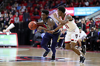 RALEIGH, NC - JANUARY 9: T.J. Gibbs #10 of the University of Notre Dame drives against Markell Johnson #11 of North Carolina State University during a game between Notre Dame and NC State at PNC Arena on January 9, 2020 in Raleigh, North Carolina.