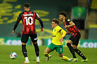17th April 2021; Carrow Road, Norwich, Norfolk, England, English Football League Championship Football, Norwich versus Bournemouth; Lloyd Kelly of Bournemouth fouls Max Aaron of Norwich City