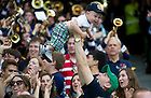 Sept. 1, 2012; A fan celebrates with his son after Notre Dame scored a touchdown against Navy during the first half of the 2012 Emerald Isle Classic at Aviva Stadium in Dublin, Ireland. Photo by Barbara Johnston/University of Notre Dame