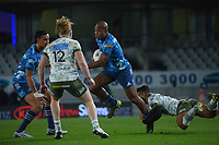 Blues' Mark Telea is tackled during the Super Rugby Tran-Tasman final between the Blues and Highlanders at Eden Park in Auckland, New Zealand on Saturday, 19 June 2020. Photo: Dave Lintott / lintottphoto.co.nz