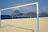 Rio de Janeiro, Brazil. The Sugar Loaf seen through the goalposts of a beach football pitch.