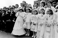 Poland. Silesia. Zabrze. Girls, wearing white skirts, and boys, with black suits and white bow ties, all dressed to make one's first Holy Communion. Row of fathers, mothers and children.  Major polluted area due heavy metals supended in the air. Zabrze is a small town, distant 20 km from Katowice.© 1991 Didier Ruef