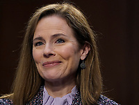 United States Supreme Court nominee Amy Coney Barrett smiles while participating in the third day of her Senate Judiciary Committee confirmation hearing on Capitol Hill on October 14, 2020 in Washington, DC. Barrett was nominated by President Donald Trump to fill the vacancy left by Justice Ruth Bader Ginsburg who passed away in September. <br /> CAP/MPI/RS<br /> ©RS/MPI/Capital Pictures