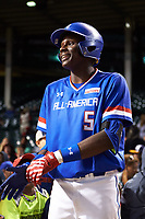 Denzel Clarke (5) of Everest Academy in Pickering, Ontario warms up in between innings during the Under Armour All-American Game presented by Baseball Factory on July 29, 2017 at Wrigley Field in Chicago, Illinois.  (Mike Janes/Four Seam Images)