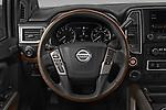 Car pictures of steering wheel view of a 2021 Nissan Titan-XD Platinum-Reserve 4 Door Pick-up Steering Wheel