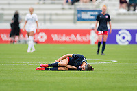 CARY, NC - APRIL 10: Ashley Hatch #33 of the Washington Spirit holds her leg in pain during a game between Washington Spirit and North Carolina Courage at Sahlen's Stadium at WakeMed Soccer Park on April 10, 2021 in Cary, North Carolina.