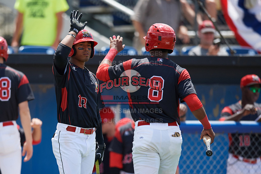 Batavia Muckdogs Jhonny Santos (13) high fives Marcos Rivera (8) after scoring a run during a game against the West Virginia Black Bears on June 25, 2017 at Dwyer Stadium in Batavia, New York.  West Virginia defeated Batavia 6-4 in the completion of the game started on June 24th.  (Mike Janes/Four Seam Images)