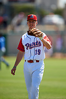 Stockton Ports shortstop Kevin Merrell (19) warms up before a California League game against the Rancho Cucamonga Quakes at Banner Island Ballpark on May 17, 2018 in Stockton, California. Stockton defeated Rancho Cucamonga 2-1. (Zachary Lucy/Four Seam Images)