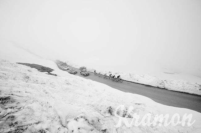 riders up the snow-covered Colle dell'Agnello (2744m)<br /> <br /> stage 19: Pinerolo(IT) - Risoul(FR) 162km<br /> 99th Giro d'Italia 2016