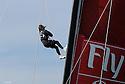 Louis Vuitton Trophy La Maddalena 29 maggio 2010. Lo stratega di Emirates Team New Zealand comincia la risalita verso la parte alta dell'albero da dove potrà meglio osservare le condizioni sul campo di gara e fornire preziose informazioni al tattico e al timoniere