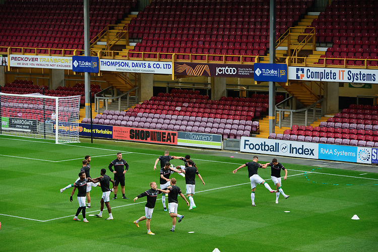 Lincoln City players during the pre-match warm-up<br /> <br /> Photographer Chris Vaughan/CameraSport<br /> <br /> Carabao Cup Second Round Northern Section - Bradford City v Lincoln City - Tuesday 15th September 2020 - Valley Parade - Bradford<br />  <br /> World Copyright © 2020 CameraSport. All rights reserved. 43 Linden Ave. Countesthorpe. Leicester. England. LE8 5PG - Tel: +44 (0) 116 277 4147 - admin@camerasport.com - www.camerasport.com