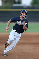 Michael Gettys #28 of the AZL Padres runs the bases during a game against the AZL Diamondbacks at the Peoria Sports Complex on July 7, 2014 in Peoria, Arizona. (Larry Goren/Four Seam Images)