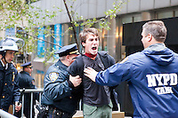 "A man is arrested as hundreds of protesters march with the aim to shut down Wall Street and the Stock Exchange on November 17, 2011 in New York City.  The action was part of a day of protests celebrating the two month anniversary of the ""Occupy Wall Street"" movement.  While many workers were inconvenienced by the human (and police) barricades, the Stock Exchange opened on schedule."
