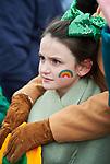 Clara Ryan keeping warm at the St Patrick's Day parade in Killaloe. Photograph by John Kelly.