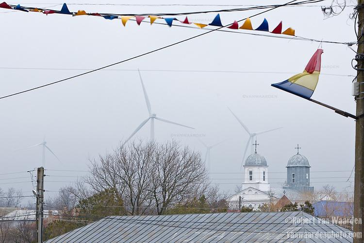 Wind turbines backdrop the small Romanian town of Fantanele.