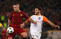 Roma s Radja Nainggolan, left, is challenged by Shakhtar Donetsk Ivan Ordets during the Uefa Champions League round of 16 second leg soccer match between Roma and Shakhtar Donetsk at Rome's Olympic stadium, March 13, 2018. Roma won. 1-0 to join the quarter finals.<br /> UPDATE IMAGES PRESS/Riccardo De Luca