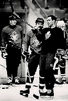 1989 FILE PHOTO - ARCHIVES -<br /> <br /> Field Marsh-Al: Defenceman Brad Marsh gives sidelined Wendel Clark some directions in yesterday's <br /> Maple Leaf<br /> workout. The team travels to Quebec city tomorrow.<br /> <br /> 1989<br /> <br /> PHOTO : Boris Spremo - Toronto Star Archives - AQP