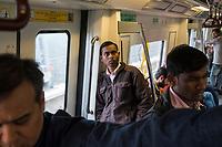 People ride the subway in Gurugram, India, on Tue., Dec. 11, 2018.