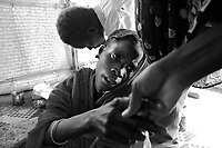 Kalma IDP camp, South Darfur, July 29 2004.Mariam cries as her yungest son, Abacar Abdallah, 25 months old, just died from severe malnutrition, weighing at only 5,2kg, despite desperate last minute efforts by the MSF medical staff to save him.