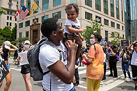 Nyron Dancy holds up his 1-year-old daughter Ny'omi Dancy during a march against police brutality and racism in Washington, D.C. on Saturday, June 6, 2020.<br /> Credit: Amanda Andrade-Rhoades / CNP/AdMedia