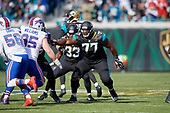 Jacksonville Jaguars Patrick Omameh (77) blocks during an NFL Wild-Card football game against the Buffalo Bills, Sunday, January 7, 2018, in Jacksonville, Fla.  (Mike Janes Photography)