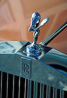 Hood ornament on Rolls Royce automobile.